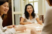 Women playing mahjong, selective focus - Alex Microstock02
