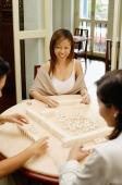 Women playing mahjong, high angle view - Alex Microstock02