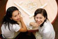 Women at mahjong table, looking at camera, high angle view - Alex Microstock02