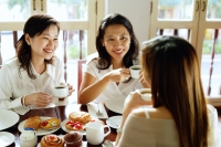 Three women having tea at cafe - Alex Microstock02