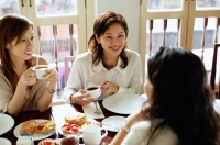 Women sitting in cafe, having tea - Alex Microstock02