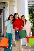 Three women with shopping bags, smiling at camera - Alex Microstock02