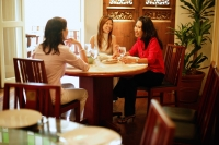 Three women having lunch at restaurant - Alex Microstock02