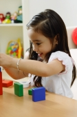 Girl playing with building blocks - Alex Microstock02