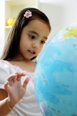 Young girl looking at globe - Alex Microstock02