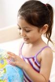 Girl looking down at globe - Alex Microstock02