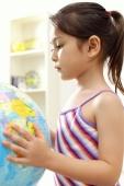 Young girl holding globe - Alex Microstock02