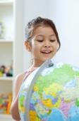 Young girl looking at globe, big smile - Alex Microstock02