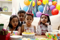 Children celebrating birthday, child blowing candles on cake - Alex Microstock02