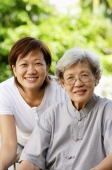 Two generations of women, smiling at camera - Alex Microstock02