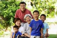 Three generation family, smiling at camera - Alex Microstock02