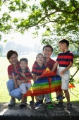 Family with three boys, outdoors, smiling at camera - Alex Microstock02