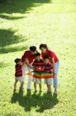 Family with three boys, outdoors with kite - Alex Microstock02