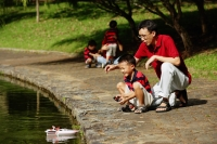 Father with son, playing with remote control boat - Alex Microstock02