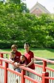 Family with two boys on bridge - Alex Microstock02