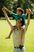 Father carrying son on shoulders, pointing up - Alex Microstock02