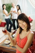 Woman holding wine glass, smiling at camera, arms crossed - Alex Microstock02