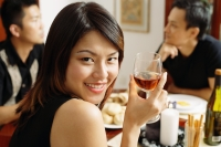 Woman with wine glass, looking over shoulder, smiling - Alex Microstock02
