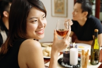 Woman with wine glass, looking away, smiling - Alex Microstock02
