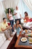 Adults in living room, smiling at camera, social gathering - Alex Microstock02