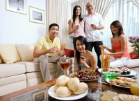 Adults in living room, having a party, smiling at camera - Alex Microstock02