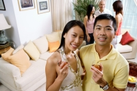 Couple with wine glasses, smiling at camera - Alex Microstock02