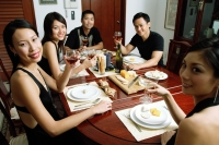 Adults having dinner party, smiling at camera - Alex Microstock02