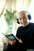 Man in black turtleneck, wearing earphones, looking at camera - Alex Microstock02