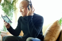 Man in black turtleneck, with headphones, listening to music - Alex Microstock02