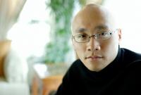 Man in black turtleneck, looking at camera, portrait - Alex Microstock02