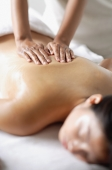 Woman undergoing back massage - Alex Microstock02