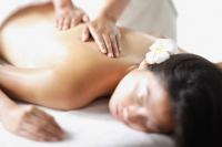 Woman lying on front, getting massaged - Alex Microstock02
