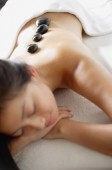 Woman relaxing with Lastone therapy massage - Alex Microstock02