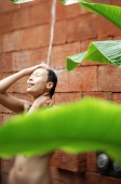 Woman taking outdoor shower - Alex Mares-Manton