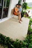 Couple sitting on patio - Alex Mares-Manton
