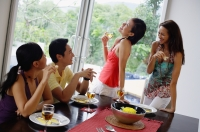 Young adults having lunch party at home - Alex Mares-Manton