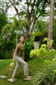 Woman walking through garden - Alex Mares-Manton
