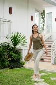 Woman walking in garden - Alex Mares-Manton