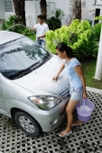 Man and woman washing car, high angle view - Alex Mares-Manton
