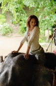 Young woman on elephant, portrait, Phuket, Thailand - Nugene Chiang