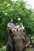 Couple riding on elephant, Phuket, Thailand - Alex Mares-Manton