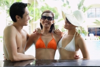 Two women and one man in swimwear, arms around each other - Alex Mares-Manton