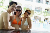 Two women and one man in swimwear, smiling - Alex Mares-Manton