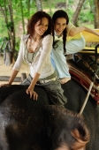 Two young women riding on elephant, Phuket, Thailand - Alex Mares-Manton