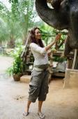 Young woman feeding elephant, Phuket, Thailand - Alex Mares-Manton