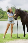 Woman petting horse - Alex Mares-Manton