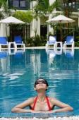 Woman in swimming pool, wearing sunglasses - Alex Mares-Manton