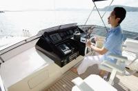 Man steering yacht - Alex Mares-Manton