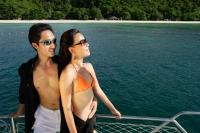 Couple on boat deck, looking away - Alex Mares-Manton