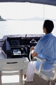 Man steering yacht, rear view - Alex Mares-Manton